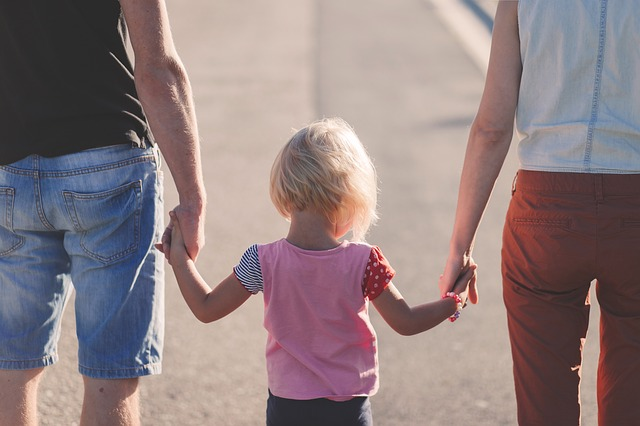 Family walking while holding hands